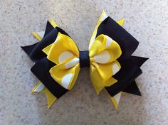 Black with yellow and white polkadots hairbow w/ tags in back- great for the holidays on Etsy, $3.50