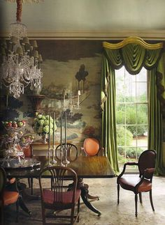 Traditional dining room with mural wallpaper.