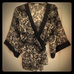 Gemini Kimono Print Top SZ M/L Gemini Kimono Print Top SZ M/L.  Black and cream.  Semi sheer.  Adorable on. Gemini Tops