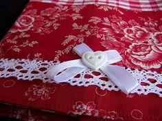 This tea towel features a gorgeous red and white designer print fabric. I have trimmed the panel with some crochet look lace and a heart button with white bow. Heart Button, White Towels, Kitchen Towels, Tea Towels, Printing On Fabric, Red And White, Print Design, Bows, Romantic