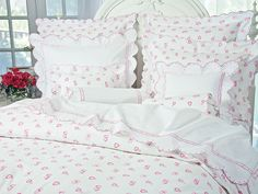 "Lovable 21. This new design is based on our idea that ""2 hearts beat as 1"" and feature a multitude of entwined hearts printed in Pink or Blue on finest White 100% cotton percale."