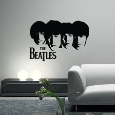 Dad's bar. THE BEATLES Decal Wall Vinyl Art Guitar Silhouette Heads John Lennon, Paul McCartney, George Harrison, Ringo Starr. $29.99, via Etsy.