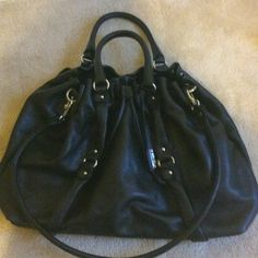 Like new Abro black leather tote Gorgeous Abro Black large leather tote with drawstring cinch top and detachable shoulder strap. Two top handles and silver hardware. Three pockets inside. Abro Bags Totes