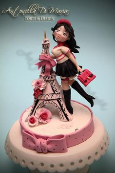 This cake has everything, a fashionable mannequin, a Paris theme and pink roses