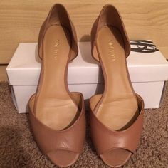 Nine West Open Peep Toe Flats Nine West Nude color Leather Upper Open Peep Toe Ballerina flats. Worn a couple of times. Back of right shoe heel has a slight scruff, shown on (photo #2). Still good condition and box included. Shoes Flats & Loafers