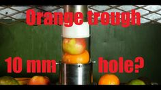 Crushing fruits through a small hole with hydraulic press