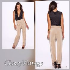 Shimmering classy dress pants. Perfect dress pants. Stylish  fold over waist band and won't wrinkle. Perfect for travel. Run true to size. These are size med. Boutique Pants Trousers