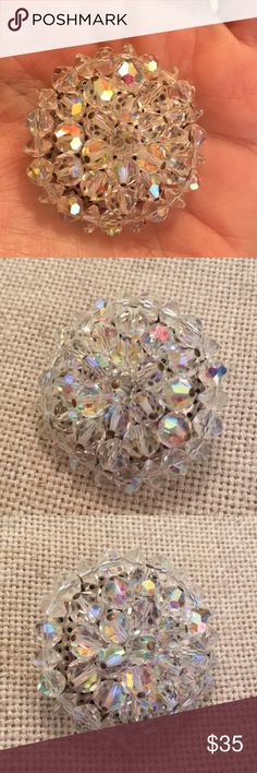 "Vintage Aurora Borealis Cut Glass Crystal Pin This was my grandmothers. She's cleaning out her jewelry box. This has a lot of shine and sparkle. Pretty cut crystal iridescent beads. Silvertone pin backing. Pin Mechanism works. Approx 1.5"" in diameter. Vintage Jewelry Brooches"