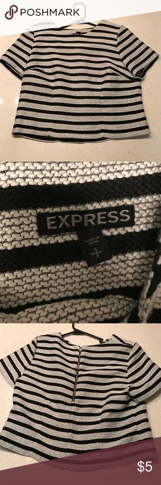 Express striped top. Black and white. Adorable! Express 100% polyester striped top. Perfect for the colder months. Really cute with a high waisted skirt. NWOT Express Tops Blouses