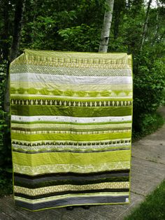 Finished! My spring-green, stripey, silky, stitched up, wool & leather quilt. | The Snug Bug