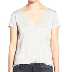 Paige Jeans V Neck T Shirt Classic V-neck tee is styled with a cute chest pocket and slightly curved hem to wear-with-everything. Modeled image same shirt but lighter color. Paige Jeans Tops Tees - Short Sleeve