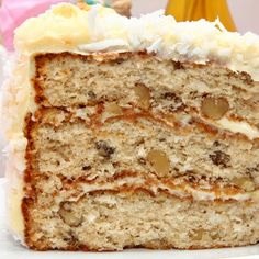This maple cake recipe makes a flavorful three layer cake that has a fluffy cream cheese frosting and is garnished with shredded coconut.  Delicious!