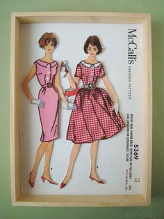 Vintage pattern with embroidery detail in shadowbox.  What a fun idea for a sewing or craft room.