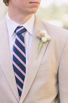 boutonniere idea// Groom in tan suit- pink and navy tie