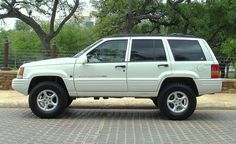 1998 5.9 Grand Cherokee with 3 inch Skyjacker springs and 265-75-16 Goodyear Wrangler TD tires.