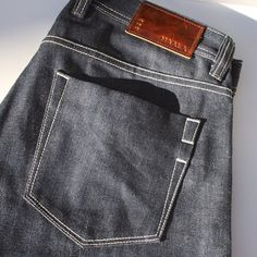 Clean back pocket detail and rich custom embossed leather patches.