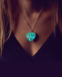 ✧ Epic Glows - Glow in the Dark Jewelry ✧  Looking for something unique? This is it! :) This is a beautiful, silver plated heart shaped pendant which shows a gorgeous aqua glow in the dark. The pendant suspends from a silver plated chain necklace. Great for the holidays, a night out or whenever you feel like wearing it! A true statement piece that will surely leave an impression :)  I made this necklace with the highest quality natural glow in the dark material that can be charged as many…