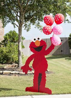 """I love to have something out in the yard to greet the guests, and who better to do the job than a life-size, wooden Elmo!"" Sarah says. ""The kids loved the giant Elmo and even swiped his balloons at the end of the party."" Source: The Crafting Mama"