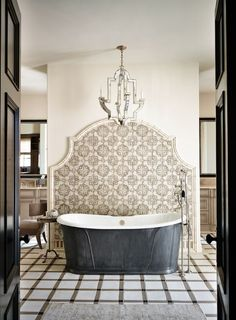 HELE- if the tub is against a solid wall then this is a good idea, Beautiful tile detail behind the freestanding tub #UniqueBaths