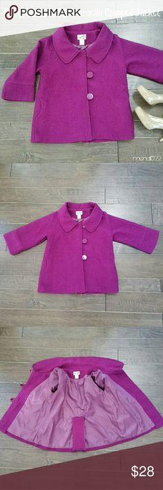 [Francesca's] Cropped Jacket Lovely plum jacket, cropped with 3/4 sleeves. Pair with a pencil skirt fir the office, or jeans and a tee for date night or girls' night out! Tweed feel; cute large buttons; fabulous collar. Silky, cozy lining.   The blazer/coat is more of a plum purple; the photos make it appear slightly brighter pink than it is.   It's also got that gorgeous Jackie O - meets - Mad Men - meets - Bond Girl retro vibe. You'll instantly fall in love with this piece!  Peace & Happy…