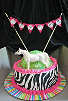 Zebra print, with white horse on top.  Pennant banner with the name is a great added touch.