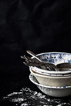 antique flatware and blue and white bowls