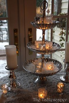 lovely winter candle tier on stacked silver candy dishes