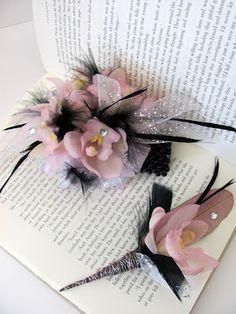 Blush mini cymbidiums with black feathers corsage and matching boutonniere