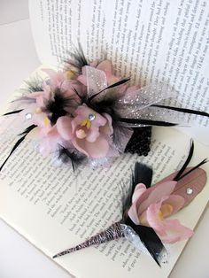 Pale pink orchids and black feathers - girly prom wrist corsage.