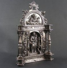 Late sixteenth century silver pax. Antique silver pax, with Madonna and child seated on the throne. Spanish ca 1590. Marked with makers mark. For sale at www.no1mayfair.com