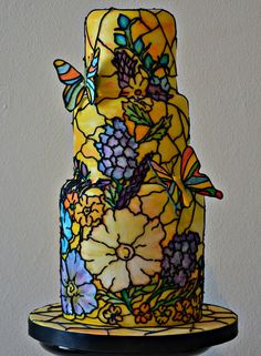 For a church wedding, a stunning stained glass effect cake will fit the bill perfectly. Made by Daisy Molly and Me, hand painted flowers in beautiful jewel colors have been delicately hand piped with royal icing.  The World's Most Amazing Wedding Cakes