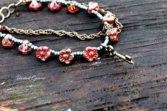 Dual strand red and teal flower bracelet by TwistedGearsJewelry