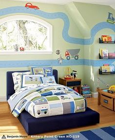 How adorable is the road on the wall? Love this room!    a room for one of my future children? i think maybe. . .
