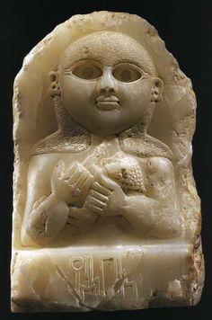Sabean Alabaster Stele Depicting a Mother and Child - X.0543 Origin: Yemen Circa: 200 BC to 100 AD Collection: Biblical Medium: Alabaster