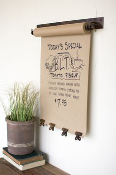 """Whether it's a grocery list, to do list, menu or just a doodle, make it special! Our note roll has 4 clips to keep you doodling in style. Replacement rolls available Product Details: Dimensions: 21"""" x"""