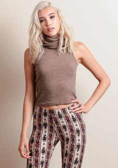 Soft and stretchy mocha-hued ribbed top featuring a slightly cropped silhouette and a turtleneck design. Perfect for adding an extra layer of warmth on colder days or for creating cool off-duty looks.