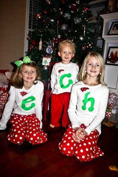 Christmas Pajama Shirt with Santa Hat and Initial Great for Christmas Pajamas for boys and girls. $31.45, via Etsy.