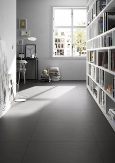 Find your collection by nameBlockMarazzi - Block porcelain stoneware flooring tiles have a brushed surface with lux and matt effects. Large Bookshelves, Bookcase, Tiled Hallway, Interior And Exterior, Interior Design, Wall And Floor Tiles, Wall Tiles, Grey Tiles, Black Floor