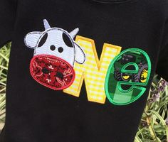 Appliqued ONE With cows head to mimic O. Shirt is shown in different color options. Prefer different colors then what is shown just message me with