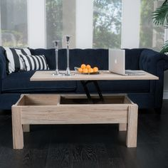The lift-top storage coffee table provides a unique way to store your belongings. It has solid mid-section that opens and lifts to use as a computer or writing desk.