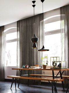 Apartment in Berlin. Beat Lights by Tom Dixon, Pirkka table and benches by Ilmari Tapiovaara.
