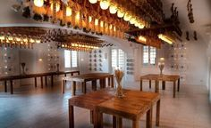 Paradise in Puglia: Pensione to the Stars. Sheaves of wheat are suspended from the ceiling, creating a warm glow in a dining area