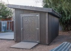 """8 ft x 16 ft, Tuff Shed sheathed with """"Rustic Trail"""" raw steel in corrugated and flat sheet stock. Tucson, Arizona The steel is heavy gauge ga) raw steel, not Corten or but will last for decades in Tucson's desert climate. Backyard Studio, Backyard Sheds, Outdoor Sheds, Steel Sheds, Steel Siding, Tuff Shed, Metal Shed, Modern Shed, Large Sheds"""