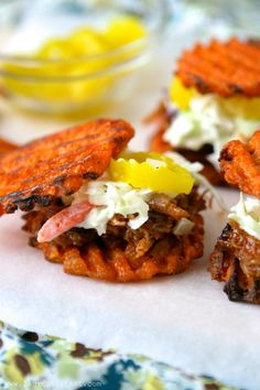 Sweet potato BBQ sliders!  Lightly fried or baked sweet potato fries, pulled pork, coleslaw, and banana pepper.