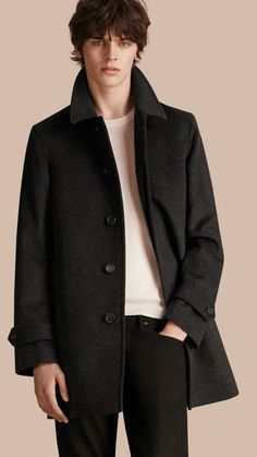A tailored Burberry car coat crafted from Italian-woven virgin wool and cashmere. The clean design features a concealed button closure and soft shoulders. Lambskin taping at the undercollar and signature button-tab cuffs complete the piece.