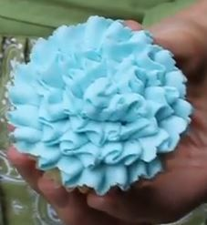 Easy Cupcake Frosting Technique  In this video  she is using a Wilton 104 frosting tip which can be