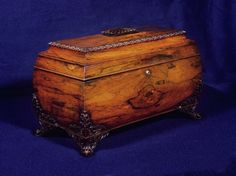 "A Large William IV Rosewood Dome-Form Tea Caddy,   CIRCA 1835,   Height: 11"" Width: 17"" Depth: 9"" - The stepped lid with egg and dart molding, opening to glass-covered canisters and mixing bowl; the scroll-form feet with elaborate foliate carving."