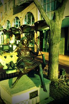 """Hearts on a Swing"""" sculpture by George Lundeen on the Pearl Street Mall. Boulder, CO"""