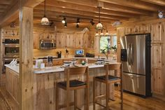 Are you looking for rustic kitchen design ideas to bring your kitchen to life? I have here great rustic kitchen design ideas to spark your creative juice. Rustic Cabin Kitchens, Log Home Kitchens, Rustic Kitchen Cabinets, Wooden Kitchen, Kitchen Interior, Pine Cabinets, Kitchen Rustic, Kitchen Counters, Knotty Pine Kitchen