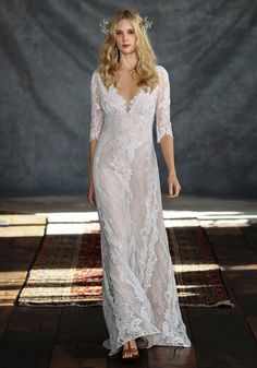Oh, Patchouli…this exquisite wedding dress marries boho romance with classic simplicity. Re-embroidered lace in a linear floral lace with plunging neckline.